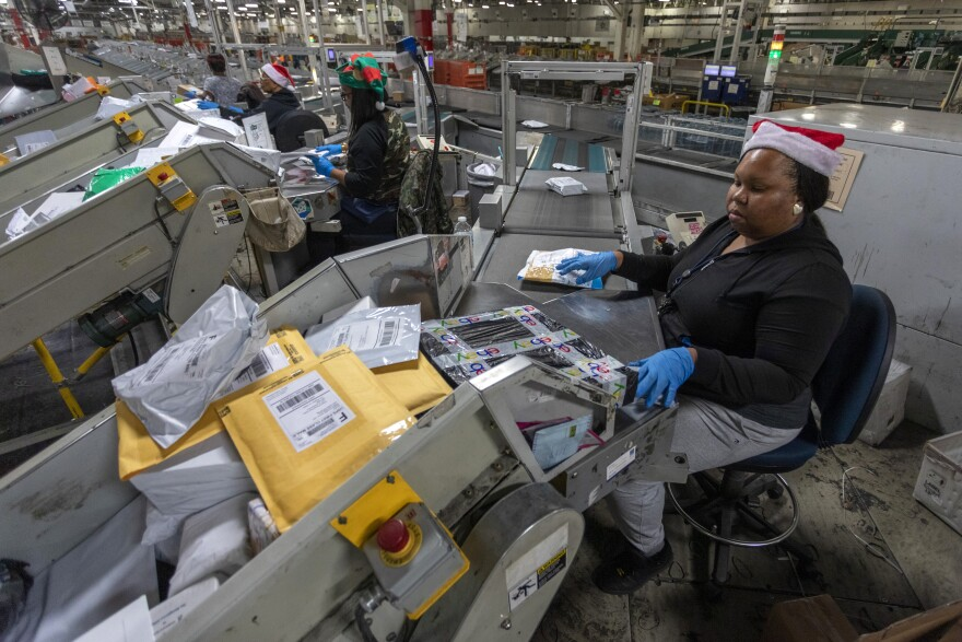 U.S. Postal Service Processes Packages At Los Angeles Distribution Center During Holiday Season