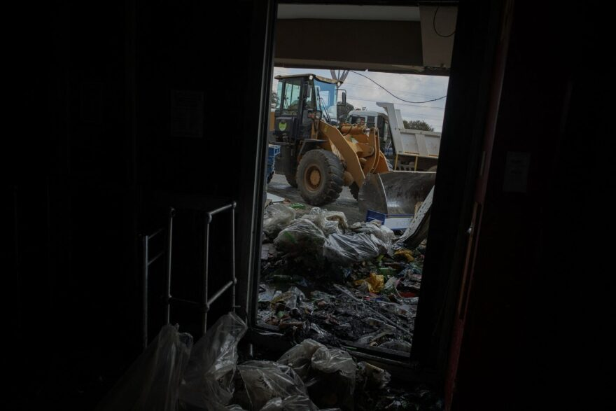 Volunteers and local workers take part in the clean up operation at the looted Bara Mall in Soweto.