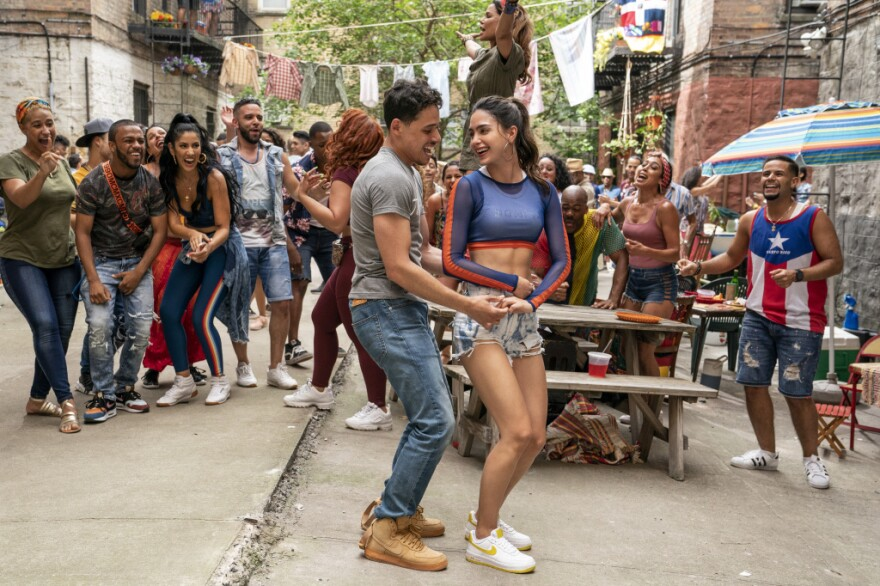 """ANTHONY RAMOS as Usnavi and MELISSA BARRERA as Vanessa in """"IN THE HEIGHTS."""" MACALL POLAY/WARNER BROS. PICTURES"""