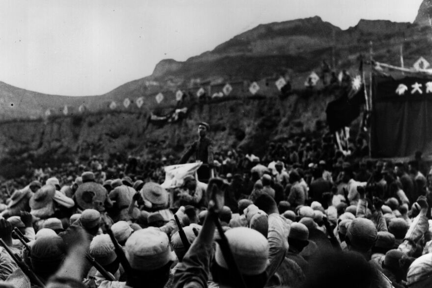 A mass meeting circa 1938 in Yenan, near the Great Wall, at the end of the Long March during the Sino-Japanese War.