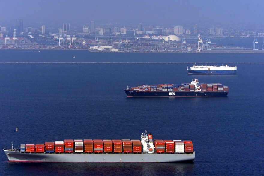 Cargo ships queue offshore to enter the docks at t