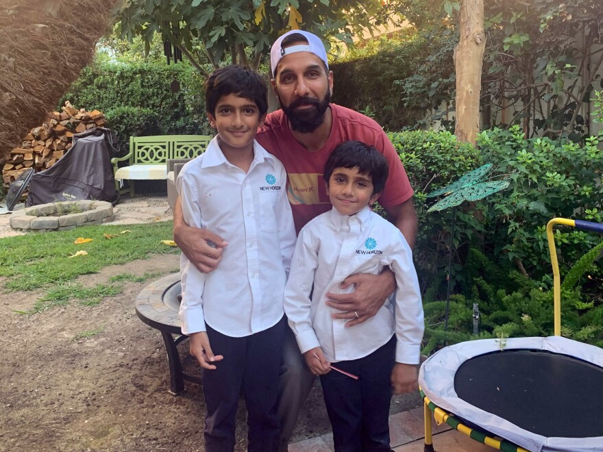 Ali Malik, 37, with his sons Muhammad Binyamin, 9, and Layth Noah, 5. Malik is part of a class action lawsuit against the FBI alleging religious discrimination and violations of surveillance laws.