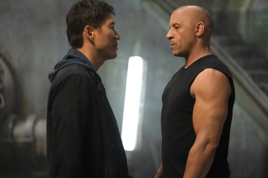 """Sung Kang (L) and Vin Diesel (R) in the film """"F9: The Fast Saga"""" GILES KEYTE/UNIVERSAL PICTURES"""