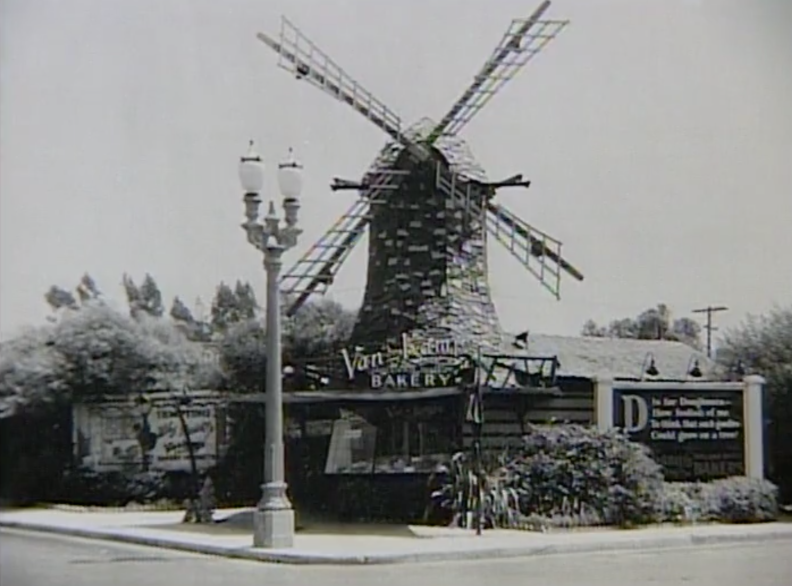 a black and white photo of a windmill-shaped building